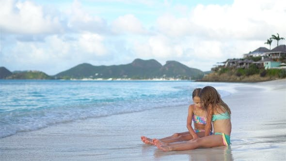 Thumbnail for Adorable Little Girls Relaxing on the Beach