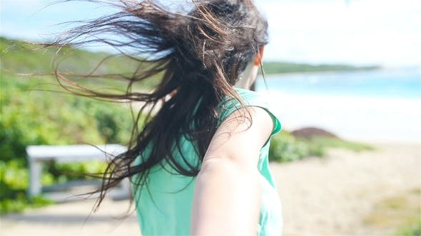 Thumbnail for Boyfriend Following Girlfriend Holding Hands on White Beach