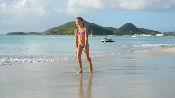 Thumbnail for Adorable Active Little Girl at Beach During Summer Vacation