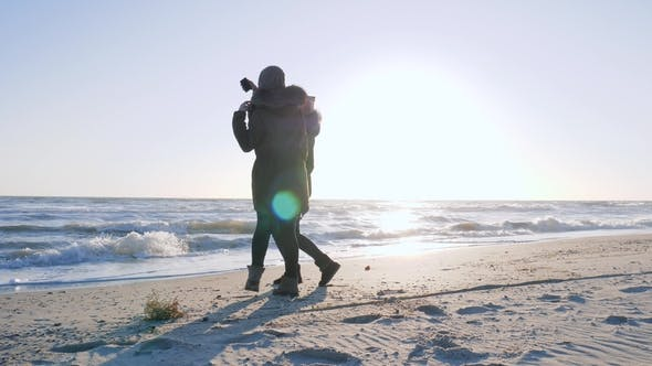 Thumbnail for Joyful People Are Photographed on Gadget on Sea in Sunlight