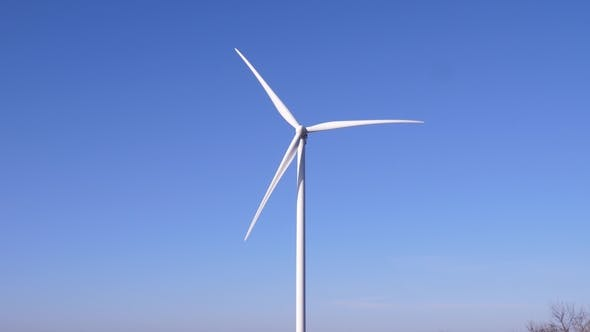 Cover Image for Big Blades of Windmill Spinning in Air on Background Blue Sky