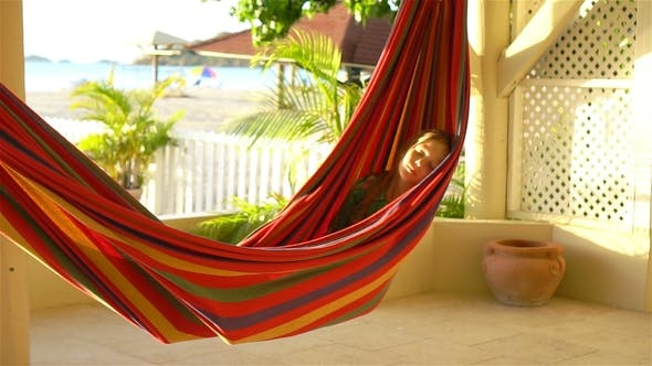 Thumbnail for Adorable Little Girl on Tropical Vacation Relaxing in Hammock