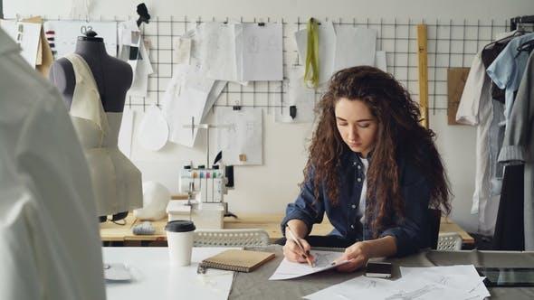 Fashion Designer Is Drawing Ladies' Garment Sketch
