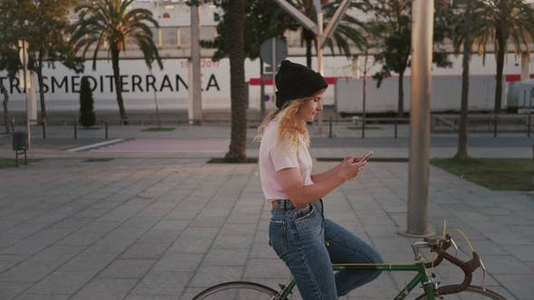 Thumbnail for Pretty Girl on Her Urban Vintage Bicycle at Sunset