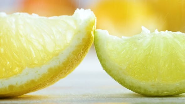 Thumbnail for Footage of Rain Falling on Lemon, Lime and Orange Slices on White Wooden Table