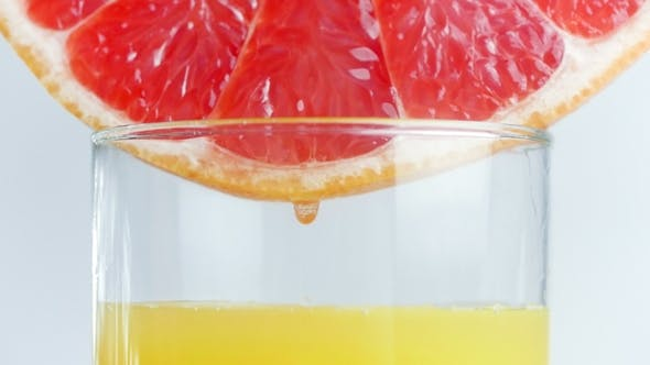 Thumbnail for Footage of Juice Droplets Flowing in Glass From Grapefruit or Red Sicilian Orange