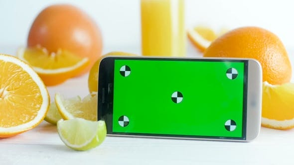 Thumbnail for Footage of Smartphone with Green Chroma Key Screen on Table Full of Orange, Limes and Lemons