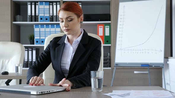 Thumbnail for Businesswoman Takes a Seat at Her Desk, Drinks a Glass of Water and Starts Typing on the Laptop