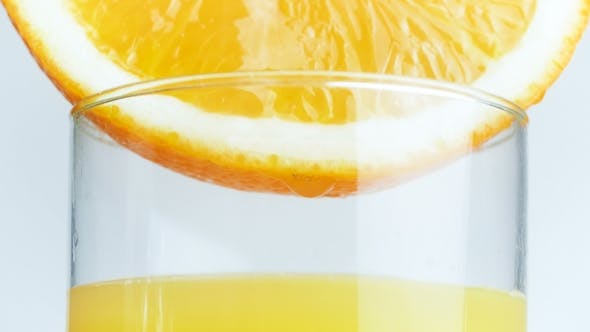 Thumbnail for Footage of Juice Droplets Falling in Glass From Orange Slice