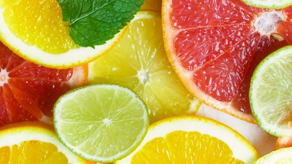 Thumbnail for Footage of Camera Moving Along Slices of Lemons, Oranges, Limes and Grapefruits with Mint Leaves