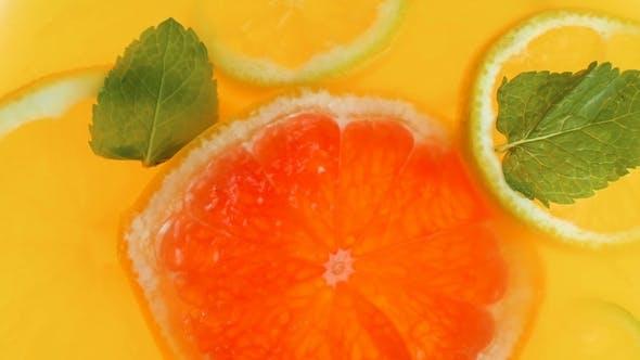 Thumbnail for Video of Lemon Slice Falling in Jar of Fresh Orange Juice