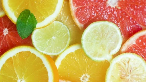 Thumbnail for Panning Video of Mint Leaves Falling on Slices of Oranges, Grapefruits and Lemons