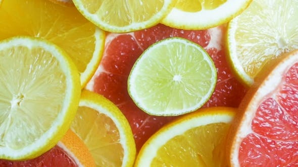 Thumbnail for Footage of Camera Moving Over Orange, Lemon and Grapefruit Slices