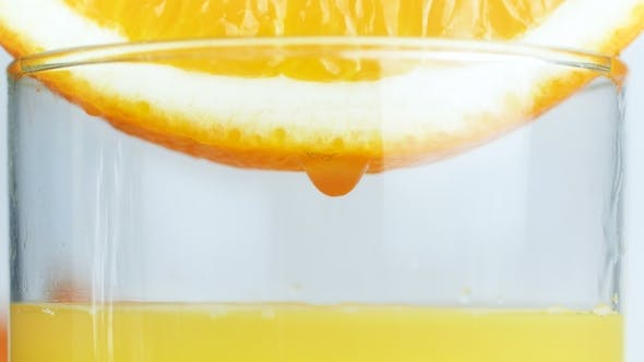 Thumbnail for Video of Orange Juice Droplets Falling in Glass