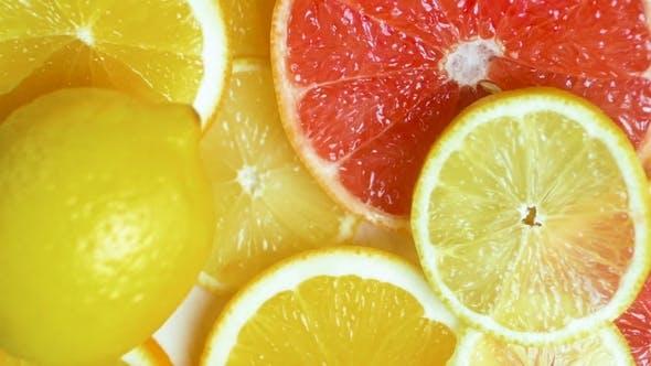 Thumbnail for Footage of Fresh Lemon Falling on Orange and Grapefruit Slices on Table
