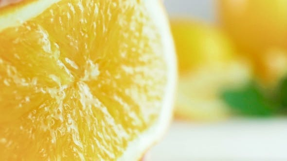 Thumbnail for Footage of Juice Bursting and Flowing From Orange Squeezed By Hand