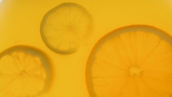 Thumbnail for Video of Citrus Fruits Slices Floating in Orange Juice