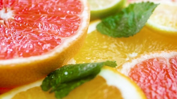Cover Image for Panning Video of Grapefruit, Lemon and Orange Slices Lying on Table