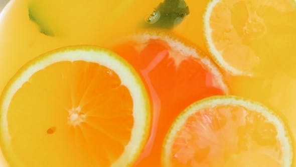 Thumbnail for View From Top of Lemonade Jar with Floating Oranges, Grapefruits and Fresh Mint Leaves