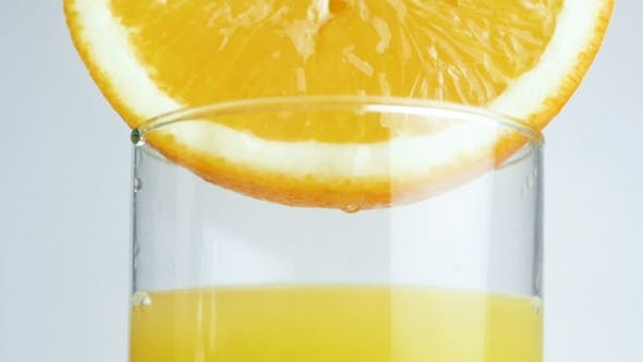 Thumbnail for Footage of Juice Droplet Slowly Dripping From Orange Half