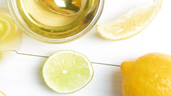 Thumbnail for View From Top on Oranges, Lemons, Grapefruits, Limes, Honey and Glass of Juice on White Wooden Table
