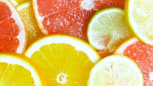 Thumbnail for View From Top of Camera Panning Along Assortment of Citrus Slices Lying on Table