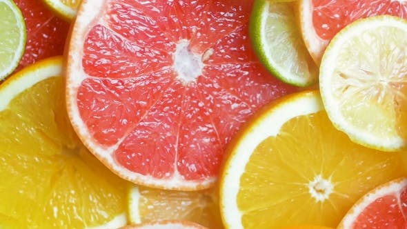 Thumbnail for Video of Assortment of Fresh Citrus Fruits Lying on Table