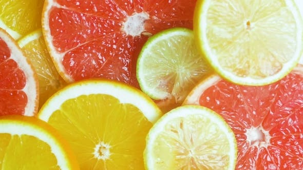 Cover Image for Video of Camera Moving Over Assortment of Citrus Fruits Lying on Table
