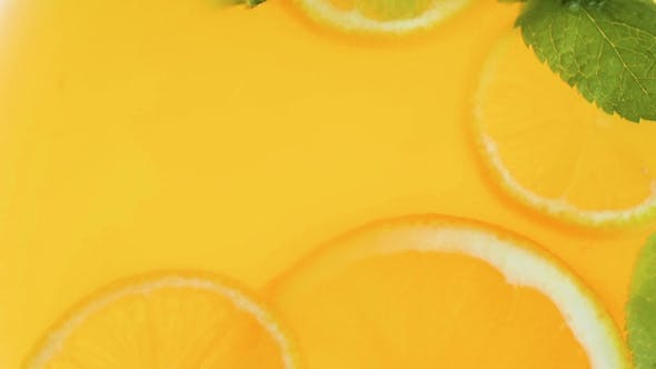 Thumbnail for Video of Orange Slices and Mint Leaves in Fresh Juice