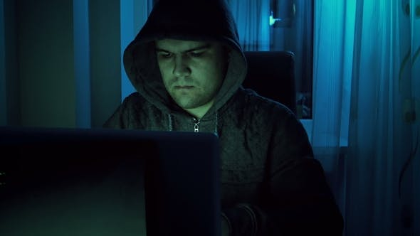 Thumbnail for Footage of Young Male Hacker in Hoodie Working on Laptop at Home in Night