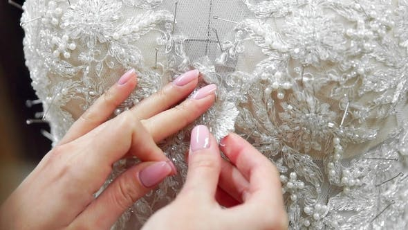Cover Image for Fashion Designer for Brides Pins Needles Lace Wedding Dress in Studio