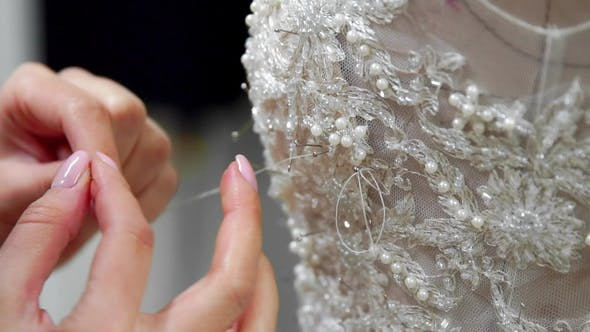 Thumbnail for Fashion Designer for Brides Pins Needles Lace Wedding Dress in Studio