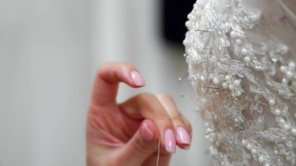 Cover Image for Fashion Designer for Brides Pins Needles Lace Wedding Dress