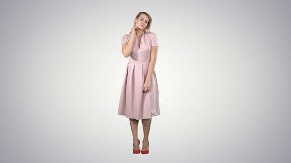 Thumbnail for Beautiful Tender Girl in Pink Dress Looking at The Mirror