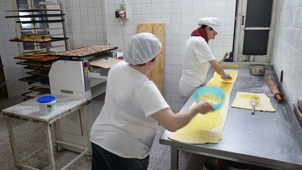 Cover Image for Traditional Italian Bakery. Two Female Bakers Prepare Sweet Buns with Cream Pasticcera