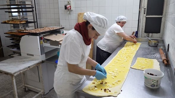 Thumbnail for Traditional Italian Bakery. Two Female Bakers Prepare Sweet Buns with Cream Pasticcera, Raisins