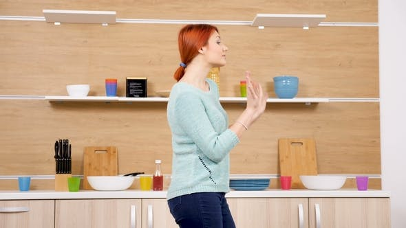 Thumbnail for Happy and Positive Woman Dances in the Kitchen