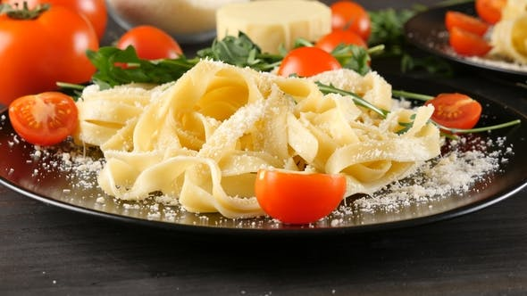 Thumbnail for Black Plate with Tagliattele Pasta with Parmesan Cheese on