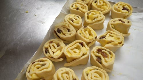 Two Female Bakers Prepare Sweet Buns with Cream Pasticcera, Raisins and
