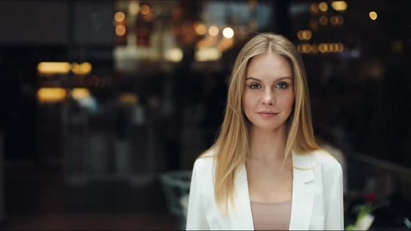 Thumbnail for Attractive Blonde Woman Looks Straight Into the Camera Standing in the Shopping Mall