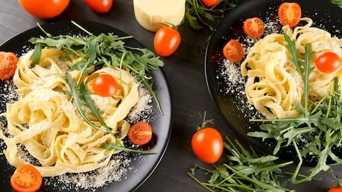 Tagliatelle Pasta in Black Plates