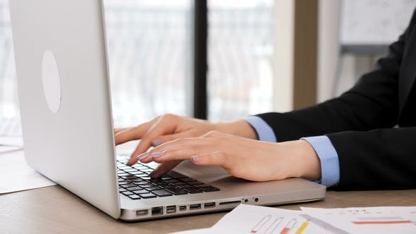 Thumbnail for Woman Hands Typing on Laptop Keyboard in the Office
