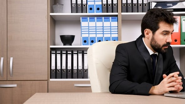 Businessman Having an Important Online Video Conference