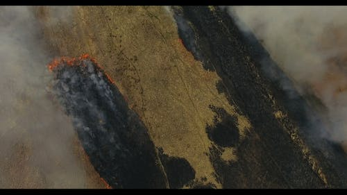 Aerial View of Burning Fields with Stubble
