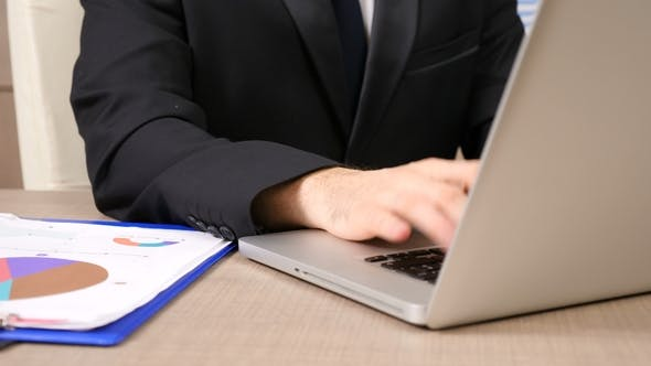 Thumbnail for Businessman at His Desk Typing on the Computer