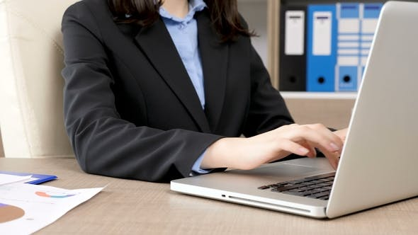 Thumbnail for of Businesswoman Hands Typing on Laptop