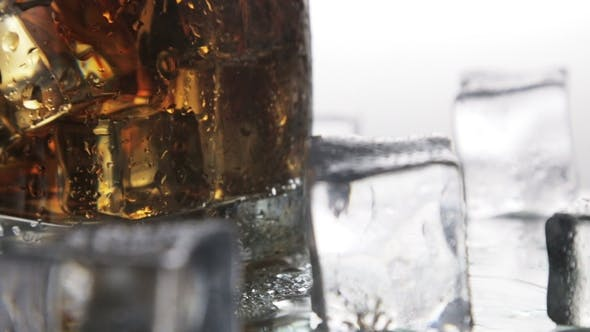 Thumbnail for Whiskey in a Glass with Ice on a Light Background
