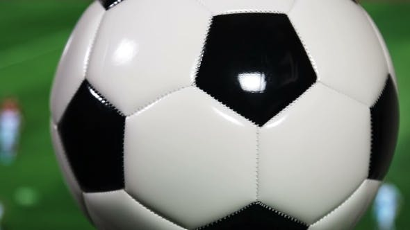 Thumbnail for the Soccer Ball Is Spinning on the Background of the Football Match