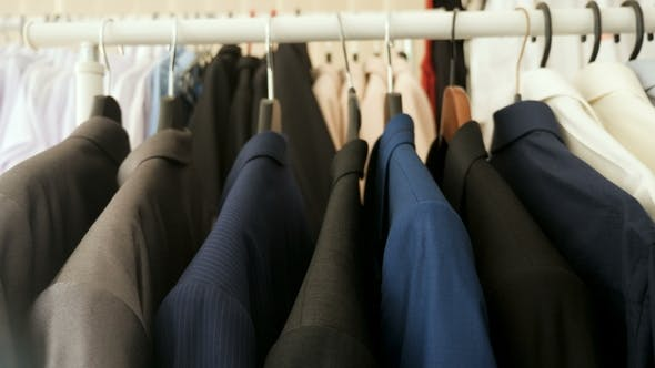 Thumbnail for Business Suits, Shirts and T-shirts on a Hanger