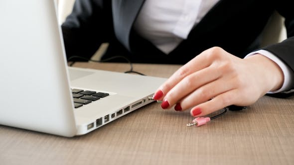 Thumbnail for Woman Typing on the Laptop Then Plugging the Cord in the Computer